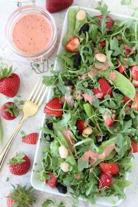 Strawberry Arugula Salad + Strawberry Champagne Dressing from the Whole Smiths. Paleo-friendly, vegan, gluten-free.
