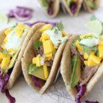 Slow cooked Pork Tacos with Mango Salsa + Cilantro Crema from the Whole Smiths. Paleo friendly, gluten and grain free.