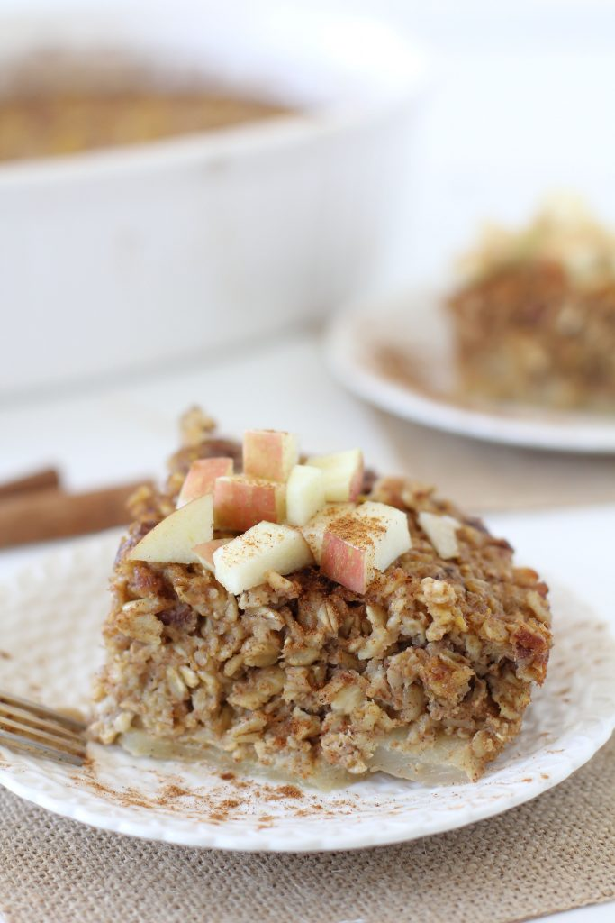 side view of a serving of Healthy Apple and Pumpkin Baked Oatmeal topped with apple cubes