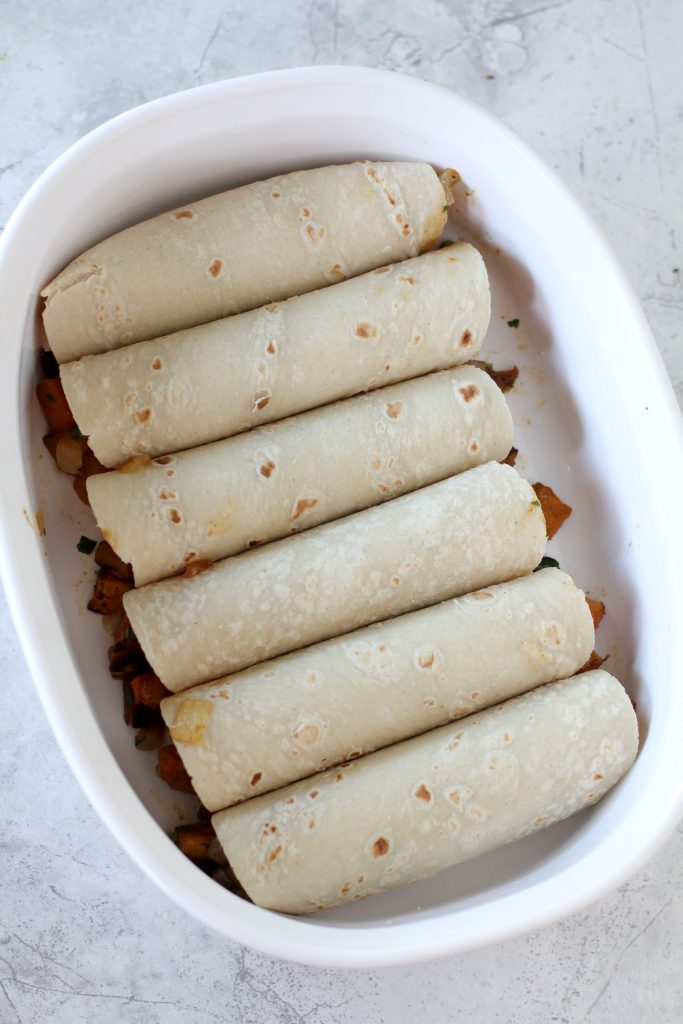Crazy easy Butternut Squash Enchiladas from the Whole Smiths. Paleo-friendly, gluten-free and vegan optional.