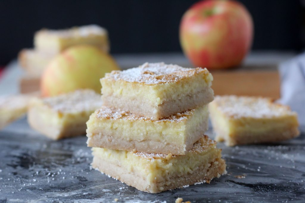 side view of three stacked apple bars with sugar-free apple cider custard and a gluten-free crust