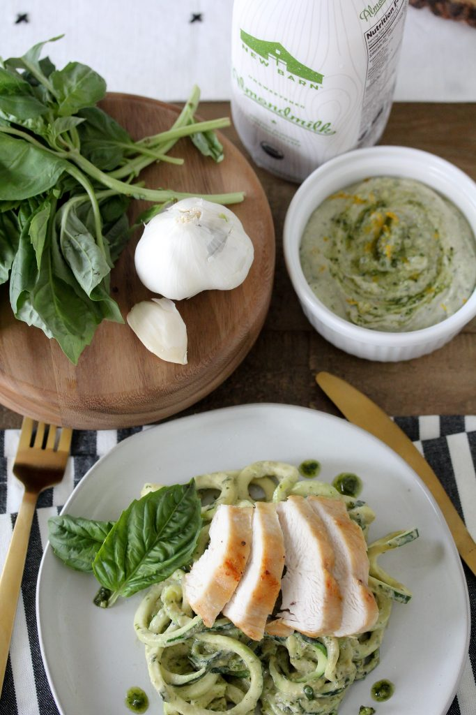 This Creamy Pesto Zoodles + Chicken recipe from The Whole Smiths is brought to you in partnership with New Barn Almondmilk. Not only is this recipe gluten-free and packed with nutrients, it's Whole30 compliant!