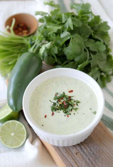 This Whole30 Green Magic Sauce from the Whole Smiths is paleo and Whole30 compliant. It's bursting with fresh flavors and perfect on anything. Anything.