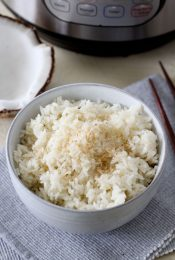 a bowl of fluffy Instant Pot coconut rice topped with shredded coconut