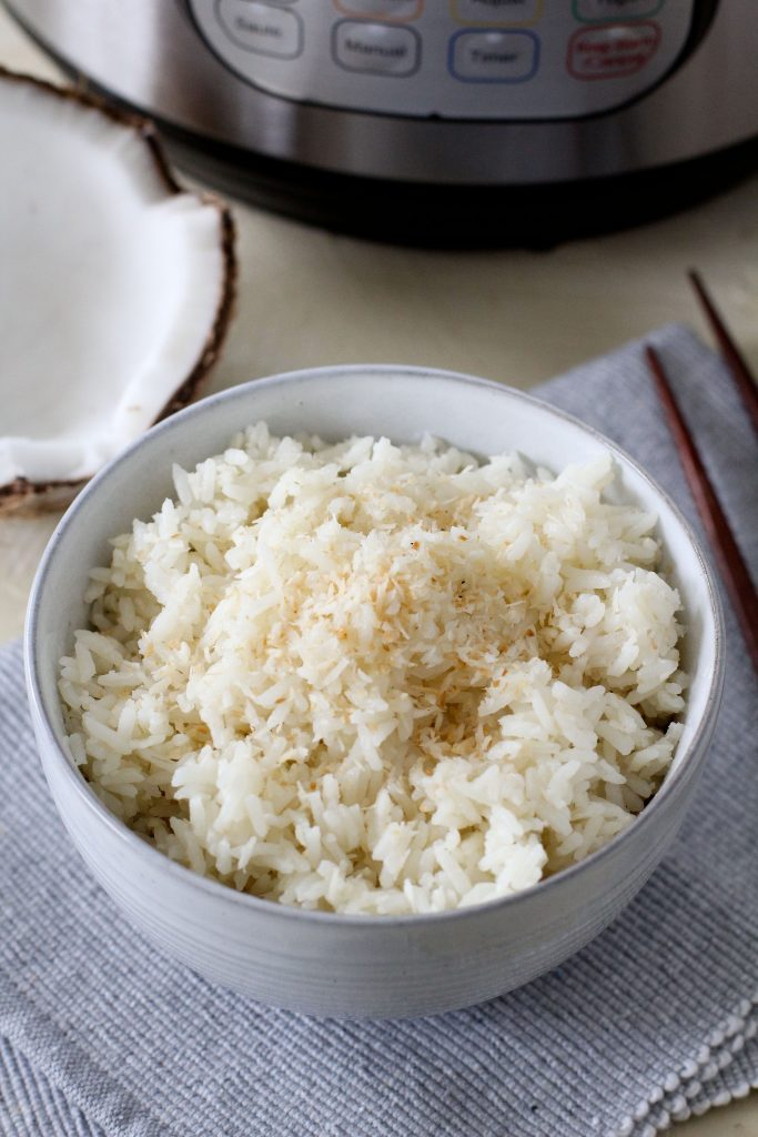 a bowl with fluffy coconut rice in a small white bowl