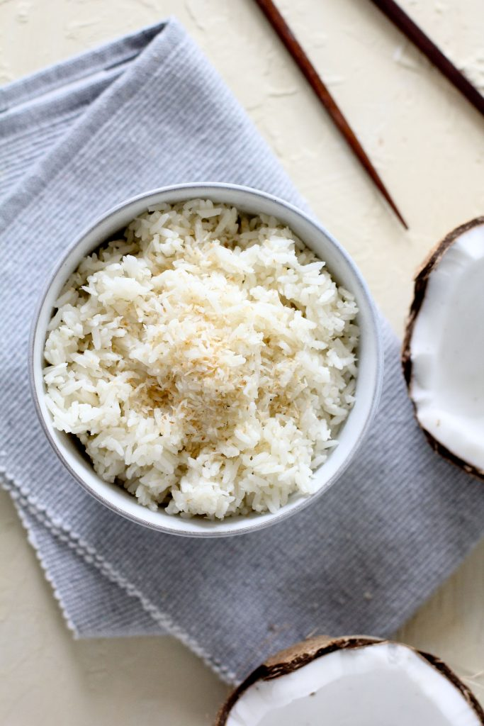 a small bowl with Instant Pot Coconut Rice on a grey cloth napkin