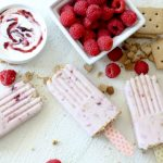 overhead shot of strawberry cheesecake popsicles with Greek Yogurt and Raspberries