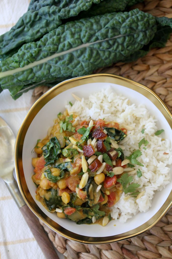 overhead shot of a bowl of healthy vegan chickpea kale curry served over rice