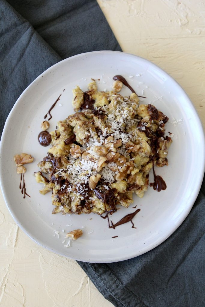 overhead shot of a plate of paleo chocolate banana eggs topped with chopped nuts