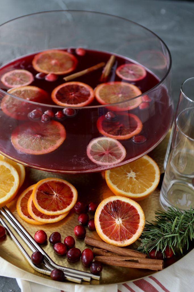 overhead shot of a big punch bowl filled with Thanksgiving punch