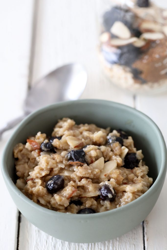 a bowl with healthy vegan vanilla blueberry oatmeal