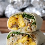 a stacked healthy glutenfree breakfast burrito stacked on a white plate