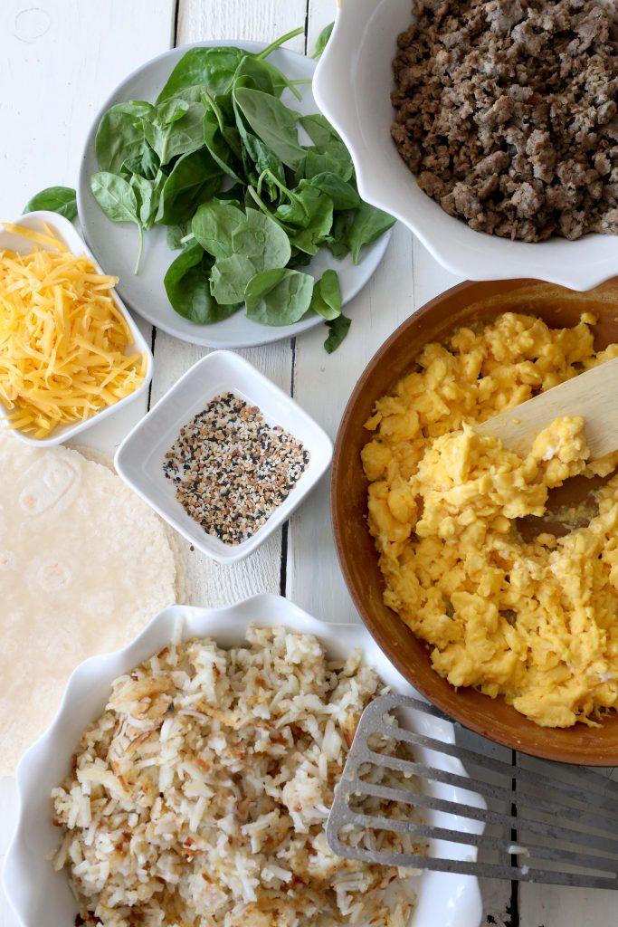 overhead shot of ingredients needed for making breakfast burritos