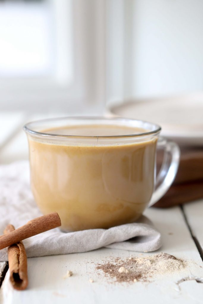 side view of a glass mug filled with dairyfree pumpkin spice chai latte with adaptogens